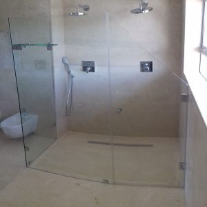Custom Cut Frameless Door Due To Window Inside The Shower Area